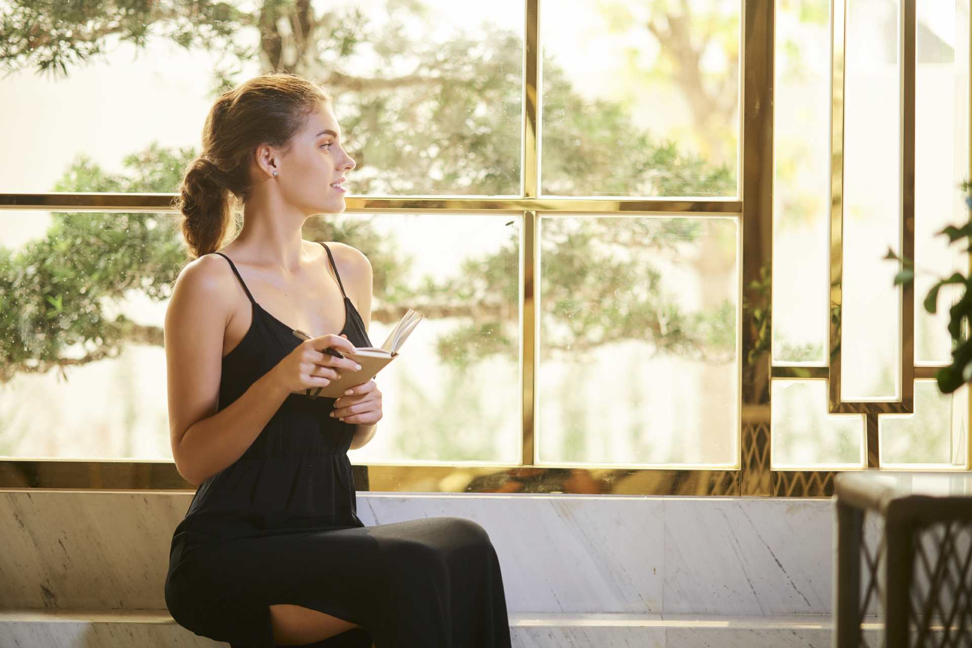 inspired-woman-sitting-at-window